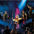 Ashley Gilmour as Enjolras, Harry Apps as Marius and Company in Les Misérables – Photograph Johan Persson