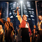 Ashley Gilmour as Enjolras and Company in Les Misérables – Photograph Johan Persson